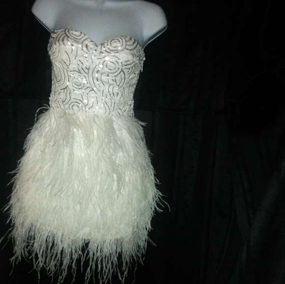 bebe Dresses & Skirts - Bebe Isis Feather and Sequin Dress